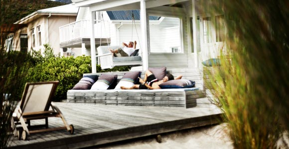 Photo: Man in hammock outside house